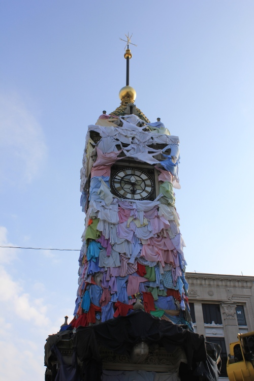 The clock all dressed up in t-shirts for Brighton Festival